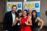 Neopost Team celebrating with champagne their AIM Award